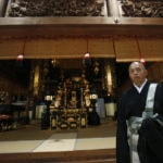 Japanese Buddhist priest contemplates canoe gold in Rio