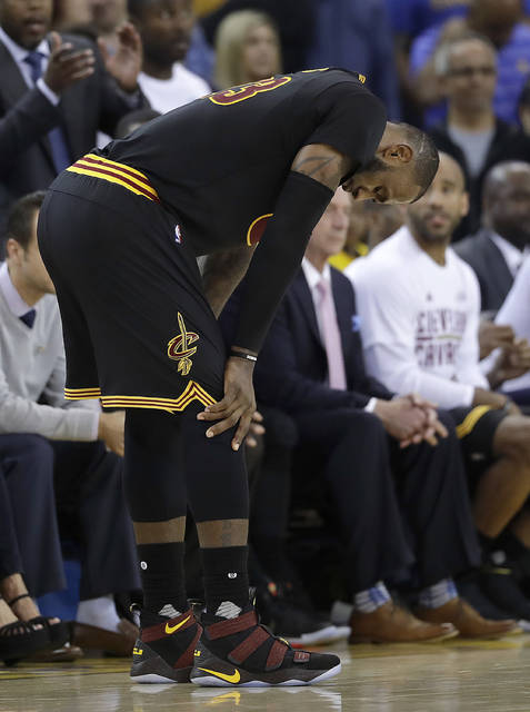 Cleveland Cavaliers forward LeBron James reacts during the second half of Game 5 of basketball's NBA Finals against the Golden State Warriors in Oakland, Calif., Monday, June 12, 2017. (AP Photo/Marcio Jose Sanchez)