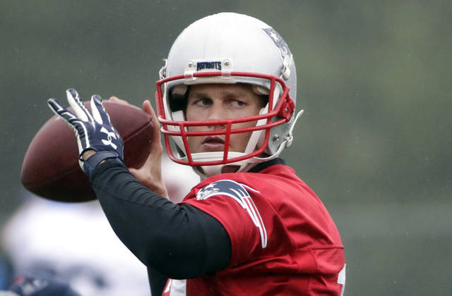 FILE- In this Tuesday, June 6, 2017, file photo, New England Patriots quarterback Tom Brady throws a pass during an NFL football team practice in Foxborough, Mass. New England went 14-2 last season, including four games without Tom Brady, but looks even stronger now. (AP Photo/Elise Amendola, File