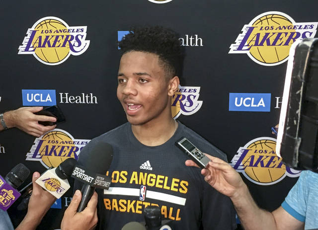 FILE - In this June 15, 2017, file photo, Markelle Fultz speaks with reporters after his private workout with the Los Angeles Lakers in El Segundo, Calif. Fultz is expected to be a top pick at the NBA Draft on Thursday, June 22. (AP Photo/Greg Beacham, FIle)
