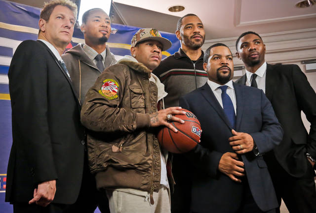 FILE - In this Jan. 11, 2017, file photo, entertainment executive Jeff Kwatinetz, far left, and Ice Cube, second from right, pose with former NBA players Kenyon Martin, second from left, Allen Iverson, third from left, Rashard Lewis, third from right, and Roger Mason, far right, after a press conference announcing the launch of BIG3, a new 3-on-3 professional basketball league, in New York. For his league of former NBA players that debuts Sunday, actor-entertainer Ice Cube insisted the competition be serious, a proper representation of a form of basketball that's so popular that it's ticketed for the next Olympics. (AP Photo/Bebeto Matthews, File)