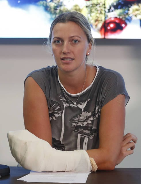 FILE - In this Friday, Dec. 23, 2016, file photo, Czech Republic's tennis player Petra Kvitova makes a statement to the media in Prague, Czech Republic. Kvitova still has not regained full strength in her left hand, the one she uses to swing a tennis racket _ and the one that was stabbed by an attacker at her home in December.  (AP Photo/Petr David Josek, file)