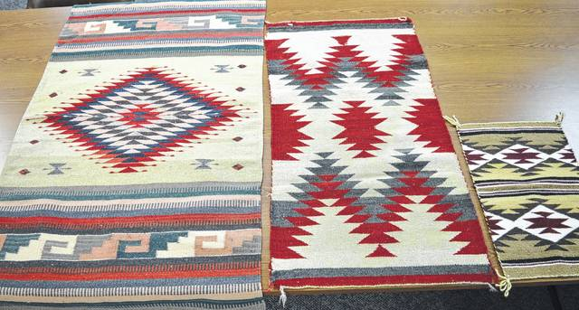 Shown are three of the rugs from Neil Snarr's collection. On the left is one from Mexico; the other two are Navajo rugs.