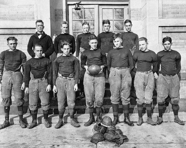 """The 1920 Wilmington High School football team was 2-3-2 on the year. From left to right, front row, Robert Haines, Donald """"Bearcat"""" Beckett, Robert Hadley, William """"Doc"""" Wire, Richard Egan, Edgar """"County"""" Brandt, Charles """"Jolly"""" Hill; back row, head coach Roy Black, John Nowald, Charles Sapp, team captain Robert Stephens and Harold """"Big Oggie"""" Ogden. A player named Grandstaff also was mentioned in News Journal reports at the time but no first name given. Other players, believed to be reserve players were John Scott, Bennett and Wright but they were not pictured here. In a story in a 1961 News Journal edition, the players reportedly had to purchase their own equipment, except for their jerseys. The shoulder and hip pads were half-inch felt, so not every player chose to wear them. Nowald was the only WHS player to be honored by the """"mythical"""" South Central Ohio football team. Letters were sent to coaches at Circleville, Hillsboro, Xenia, Wilmington, Chillicothe and Washington high schools to vote on the team members. Of course, the """"real"""" SCOL didn't begin until fall 1923. Nowald would later return to WHS as athletic coach. Charles Sapp was deemed by News Journal sports editor Kroger Babb in 1926 to the be the greatest quarterback to ever wear the orange and black of WHS. Roy Black was one of the most successful coaches in WHS history. Black also taught at Martinsville, Jefferson, Mt. Pleasant, Lebanon, Urbana, Circleville and Wooster school districts."""