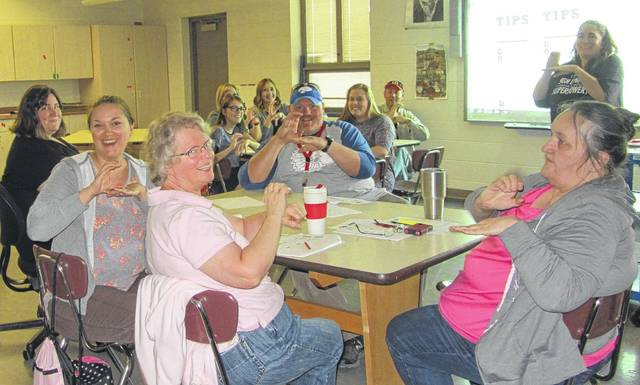 Area teachers learn basic sign language skills to better assist students.
