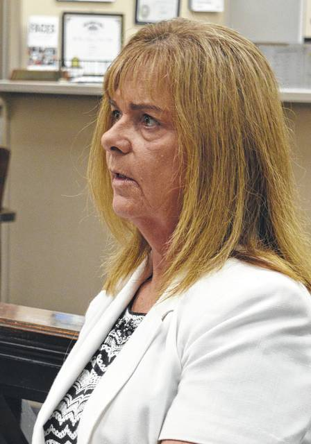 Cheryl Babb with the Clinton County Job and Family Services speaks with Clinton County commissioners Wednesday about a squeeze in finances occurring due to a jump in foster care placements in the county.