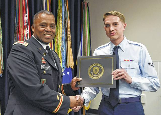 U.S. Air Force Airman Marc Wilson receives congratulations upon completing the 77-day course.