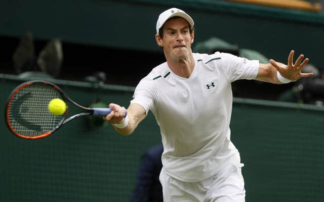 Britain's Andy Murray returns to Kazakhstan's Alexander Bublik during their Men's Singles Match on the opening day at the Wimbledon Tennis Championships in London Monday, July 3, 2017. (AP Photo/Kirsty Wigglesworth)
