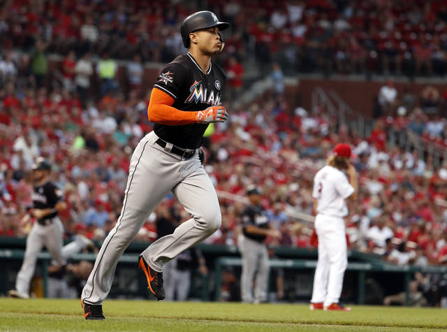 Miami Marlins' Giancarlo Stanton, left, rounds the bases after hitting a three-run home run off St. Louis Cardinals starting pitcher Mike Leake during the second inning of a baseball game Wednesday, July 5, 2017, in St. Louis. (AP Photo/Jeff Roberson)