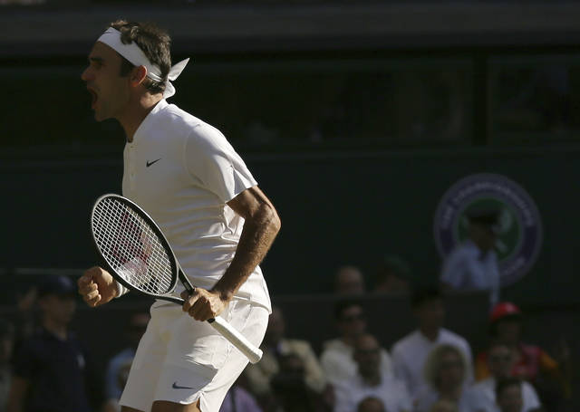 Switzerland's Roger Federer celebrates after beating Canada's Milos Raonic at the end of their Men's Singles Quarterfinal Match on day nine at the Wimbledon Tennis Championships in London Wednesday, July 12, 2017. (AP Photo/Tim Ireland)