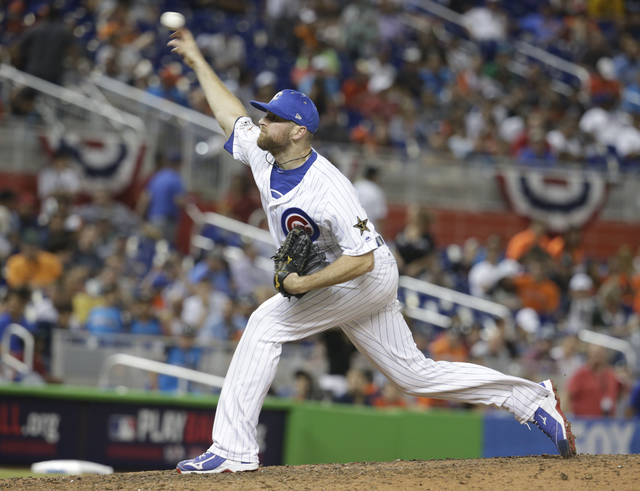 National League's Chicago Cubs pitcher Wade Davis (71), delivers a pitch in the tenth inning, during the MLB baseball All-Star Game, Tuesday, July 11, 2017, in Miami. (AP Photo/Lynne Sladky)