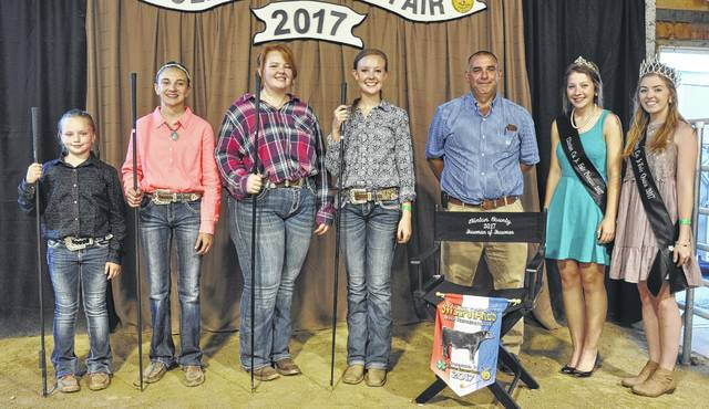 For Beef Showmanship winners, from left are Beginner Taylor Barton, Junior Delaney Schneder, Intermediate Ashleigh Osborn, Senior and Showman of Showmen Anne Thompson who will be representing Beef Barn in the Tony Grapevine Contest, Judge Jimmy Simpson, Fair Queen Bridgette Thompson, and Fair Princess Olivia Woods.