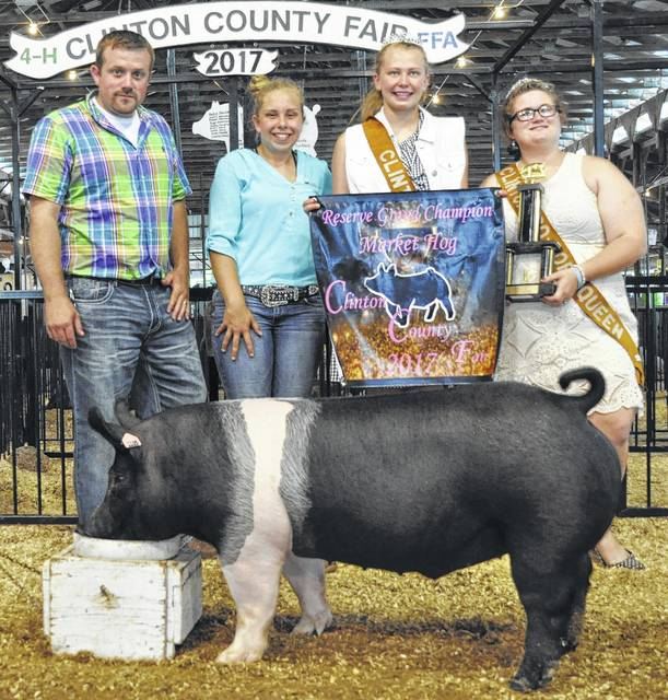 Reserve Grand Champion Market Hog went to Madison Abt. Shown from left are Judge Travis Platt, Madison Abt, Pork Princess Madison Bonner, and Pork Queen Cassandra Parks.