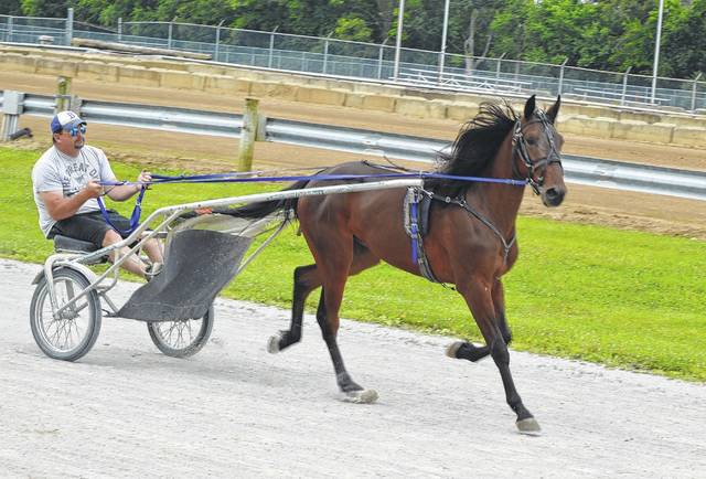 Some harness racers were taking some practice time Wednesday at the Clinton County Fairgrounds, readying themselves for events that occur early during fair week. Harness racing is scheduled to start 4 p.m. on Sunday and also on Monday in front of the grandstand which features a newly extended roof.