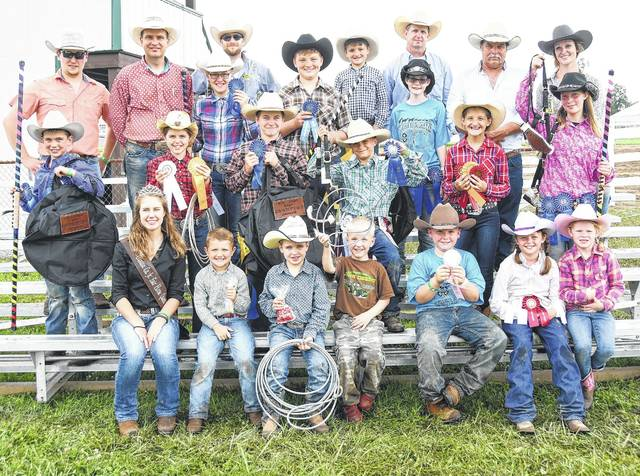 Shown are the ribbon winners, participants, advisers, the judge, and contributors (still there) at the end of the Clinton County Fair Roping Show. From left are: Front row, Horse Queen Kari Cragwall, Gatlin Smith, Parker Dixon, Charlie Erickson, Mia VanGundy, and Bella Mohanes; second row, Preston Dixon, Diamond Carpenter, Brody Fisher, Luke Van Gundy, Lisbon Smith, and Shylynn Flint; and, back row, Wyatt Fyffe, Josh Dixon, Timmi Mohanes, Tyler Lovedahl, Remington Smith, Gentry Smith, Rich Corzatt, the judge, and Amanda Adkins.