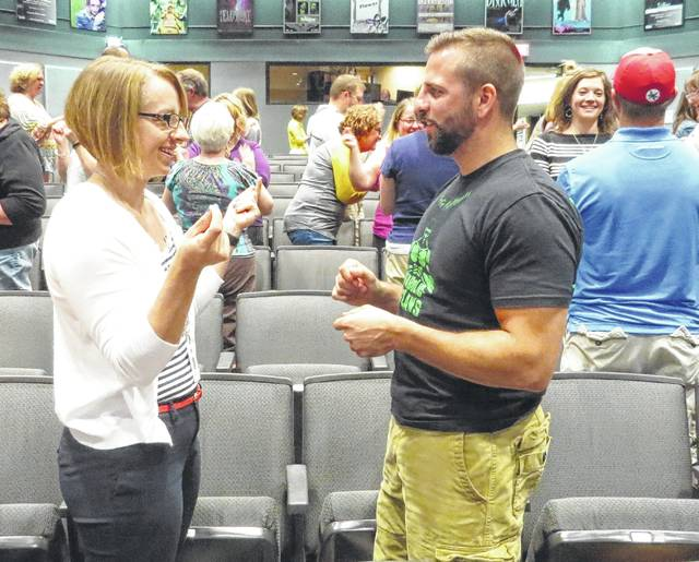 Jenny Spurlock and Thomas Sodini, both of the Southern Ohio Learning Center, participate in hand and word play to better understand how students' brains respond during learning activities.
