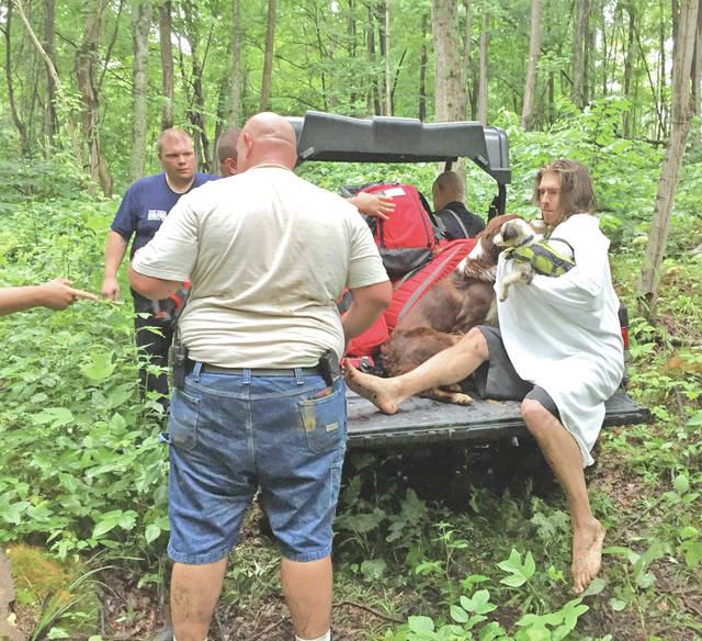 James Brightman, right, and his two dogs are pictured following their rescue after being trapped Thursday in the Rocky Fork Gorge. Local emergency responders rescued three people and two dogs after their kayaks flipped over.