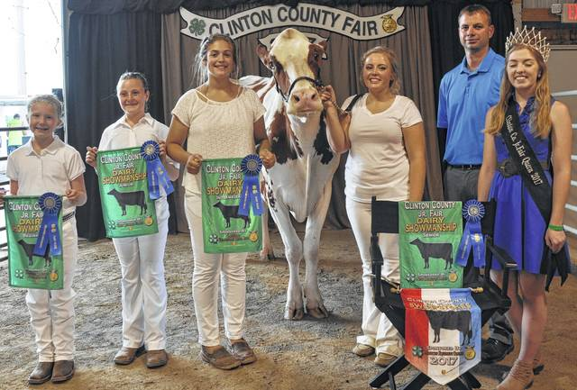 In Dairy Showmanship competition, from left are beginner division winner Shelby Leaming, junior division winner Nikita White, intermediate division winner Maggie Mathews, senior division winner Emma Mathews, judge Chris Lahners and Clinton County Fair Queen Bridgett Thompson. Emma Mathews will represent the Dairy Barn in the Tony Grapevine Sweepstakes.