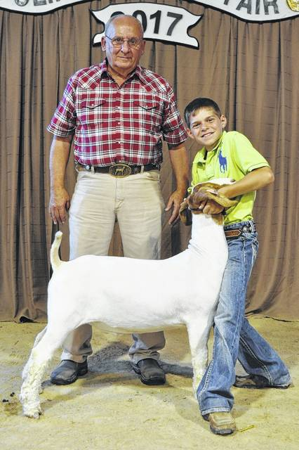 In the Open Market Goat Show, shown are Grand Champion Jaden Snyder and Judge Bob Hare.