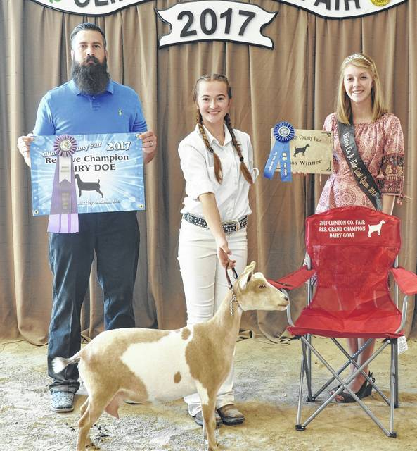 For Reserve Grand Champion Dairy Goat, shown are Judge Phil Meyers, winner Kaylashae Moore, and Goat Queen Katie Hughes.