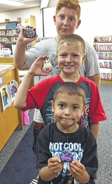 "Isaac, Austin and Brody recently located Kindness Rocks that were painted and hidden by staff at the Sabina Library. The goal of this project is to unexpectedly brighten someone's day and pass along some kindness one rock at a time. This is done by painting a positive message or image on the rock and then placing the rock in plain sight in the local community for someone to find. When someone finds a rock, they can post a photo or message on the library's Facebook group, ""Sabina Library Rocks"", so others can have fun tracking the location of rocks. Several events will be held at the Sabina Library soon to allow patrons to help with the painting and hiding of more Kindness Rocks."