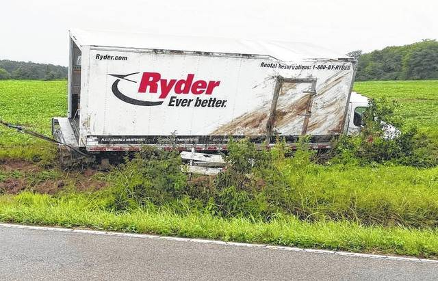 A Ryder truck ran off South Clarksville Road near Wilmington Road on Thursday afternoon, ending up on its side in a muddy field. No injuries were reported.