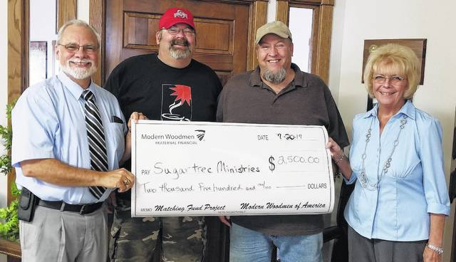 Shown are: Dan Mayo, Modern Woodmen District Agent; Ron Cordy, Sugartree Recovery Director; Allen Willoughby, Sugartree Ministries Director; and Bev Mayo, Modern Woodmen Wilmington Chapter 4288 President.