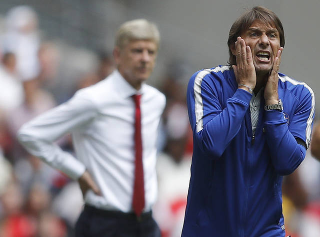 "FILE - This is a Sunday, Aug. 6, 2017  file photo of Chelsea's team manager Antonio Conte, right, and Arsenal manager Arsene Wenger as they react during the English Community Shield soccer match between Arsenal and Chelsea at Wembley Stadium in London.  Antonio Conte ignited the first managerial feud of the season when he said that Chelsea must avoid ""a Mourinho season"" as the champions seek to defend their Premier League title. (AP Photo/Frank Augstein/File)"
