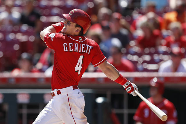 Cincinnati Reds' Scooter Gennett hits a go-ahead grand slam off San Diego Padres relief pitcher Brad Hand in the seventh inning of a baseball game, Thursday, Aug. 10, 2017, in Cincinnati. (AP Photo/John Minchillo)