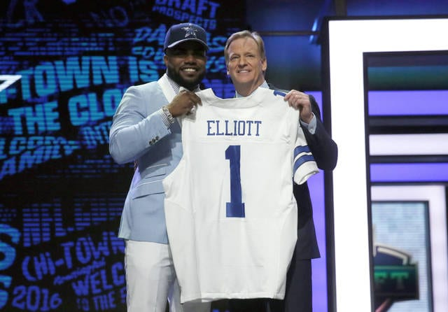 "FILE - In this April 28, 2016, file photo, Ohio State's Ezekiel Elliott poses for photos with NFL commissioner Roger Goodell after being selected by the Dallas Cowboys as the fourth pick in the first round of the 2016 NFL football draft, in Chicago. Elliott has been suspended for six games under the NFL's personal conduct policy following the league's yearlong investigation into the star Dallas Cowboys running back's domestic violence case out of Ohio.  The league said Friday, Aug. 11, 2017, there was ""substantial and persuasive evidence"" that Elliott had physical confrontations last summer with his ex-girlfriend, Tiffany Thompson.(AP Photo/Charles Rex Arbogast, File)"