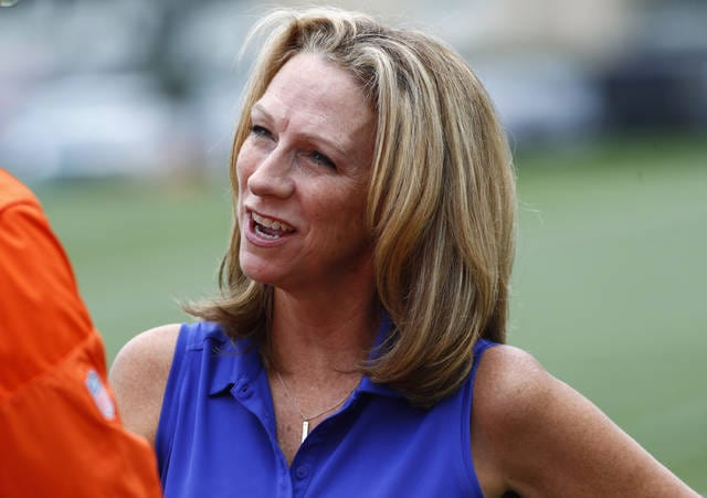 FILE - In this Saturday, July 29, 2017, file photo, broadcaster Beth Mowins chats with a reporter at the Denver Broncos NFL football training camp in Englewood, Colo. Mowins will become the first woman to call NFL play-by-play for CBS. Mowins will team with former NFL kicker Jay Feely for her debut on Sept. 24 when Cleveland plays at Indianapolis. The network released its announcer pairings Tuesday, Aug. 15, 2017. (AP Photo/David Zalubowski, File)