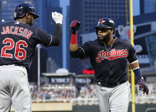 Cleveland Indians' Carlos Santana, right, celebrates his solo home run off Minnesota Twins pitcher Bartolo Colon with Austin Jackson in the fourth inning of a baseball game Tuesday, Aug. 15, 2017, in Minneapolis. (AP Photo/Jim Mone)