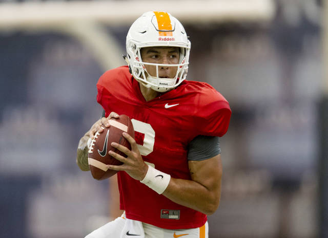 FILE - In this Tuesday, April 18, 2017 file photo, Tennessee quarterback Jarrett Guarantano (2) participates in the team's spring practice at Anderson Training Facility in Knoxville, Tenn. This could turn into a big year for redshirt freshman quarterbacks in the Southeastern Conference. It all depends on how a few preseason competitions turn out. Florida, Tennessee and Texas A&M all have redshirt freshman quarterbacks bidding for starting spots. None of the three schools has named a starter. Tennessee's quarterback derby features redshirt freshman Jarrett Guarantano and junior Quinten Dormady. (Calvin Mattheis/Knoxville News Sentinel via AP, File)