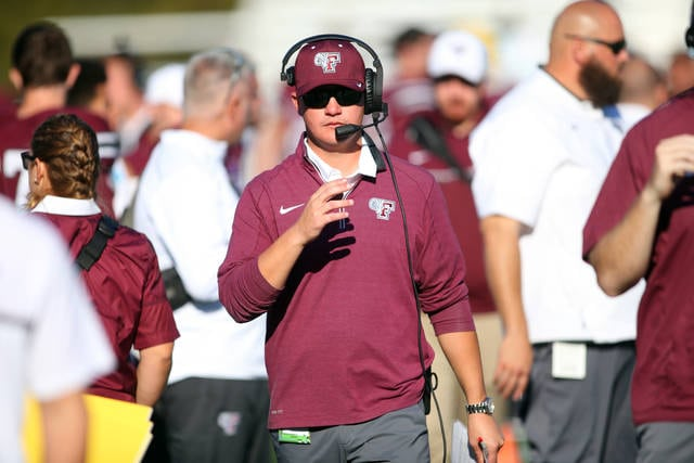 In this photo provided by Fordham Athletics, Fordham football coach Andrew Briener stands on the sideline during the NCAA college football team's game against Yale on Oct. 15, 2016, in New York.Breiner, considered one of the bright young offensive minds in college coaching, let the AP sit in on a summer game-planning meeting, and then explained how he and his staff do it during the season. (Vincent Dusovic/Fordham Athletics vs AP)