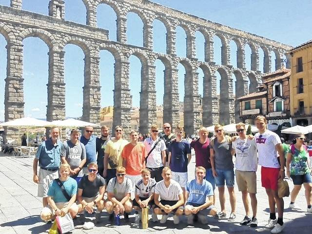 The Wilmington College men's soccer team in front of an aqueduct built in the early second century in the historic Spanish city of Segovia.