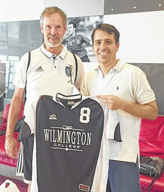 Wilmington College men's soccer coach Bud Lewis and Nacho Sanchez, who arranged the team's tour to Spain.