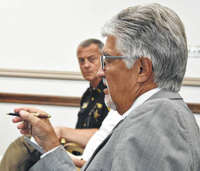 "Clinton County Common Pleas Judge John W. ""Tim"" Rudduck, foreground, says he will hire a recovery liaison to strengthen the local effort to oppose the opiate scourge. In the photo's background, Clinton County Sheriff Ralph Fizer Jr. is listening."