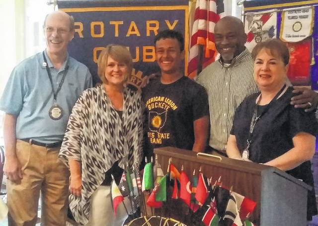 Seth Murdock (middle) is flanked by his parents, Tina and Chip, and Rotary President Chuck Watts and Vice President Melissa Reeder.