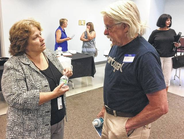 After the program, speaker Beth Short speaks with Jim Armstrong of the Port William-Lumberton Senior Center.
