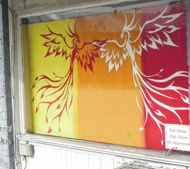 This is one of the eye-catching paintings placed in empty storefront windows in downtown Sabina, thanks to the Sabina Lions Club and East Clinton High School Art Department students.