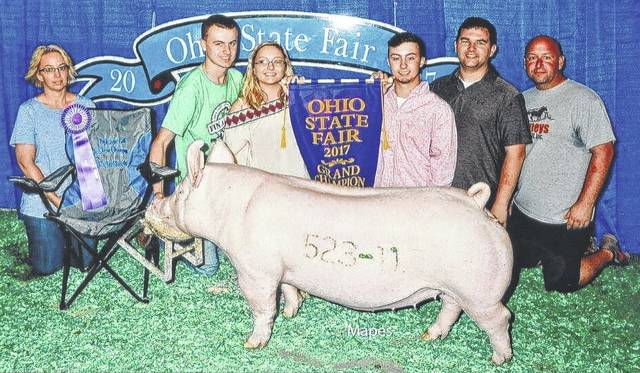 Andrew Davis exhibited the grand champion Yorkshire gilt in the Open Show at the 2017 Ohio State Fair, and Lauren Davis exhibited the champion Yorkshire gilt in the Junior Show at the '17 Ohio State Fair. Both are with the Final Drive 4-H Club. In the photograph from left are Alison Davis, Matt Younker, Lauren Davis, Andrew Davis, Alex Anderson and John Carney.