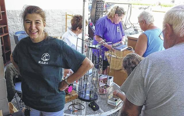 Cars and shoppers packed the parking lot and lined up on U.S 68 Saturday morning for the fundraising yard sale at the Wilmington Area Humane Society.