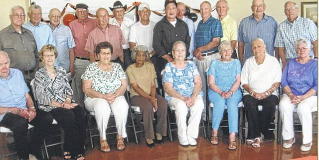 At the reunion were, from left: first row, Darrell Pidgeon, Kay Curtis Heringhaus, Shirley Williams Bogan, Evelyn Peyton Burns, Edith Shiveley Deininger, Ruth Pendry Miguel, Becky Hazard Rauch, and Gladys Hughes Bobbit; second row, Gene Bias, David Hale, Phil Carnes, Lyndell Suggs, John Hackney, Glenn Dupree, Macey Cordell, Forest Goings, Dale Stokes, Kent Turner, David Terrell, Bob Webb and Dan Inlow.