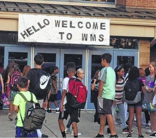 """Wilmington Middle School kicked off the school year Wednesday with the Sandy Hook Promise, """"Start With Hello."""" Students were greeted by staff members with a warm, """"Hello"""" as they walked under a welcome banner to enter the building. """"The Start With Hello program teaches students the skills they need to reach out to and include those who may be dealing with chronic social isolation and create a culture of inclusion and connectedness within their school,"""" said WMS Guidance Counselor Mary Groves. """"Students will complete various activities the first week and through the school year that are designed to reduce social isolation within the school and our community."""" —"""