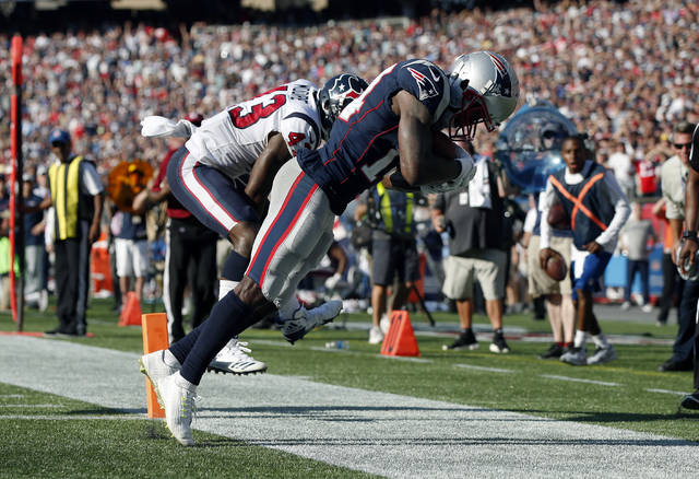 New England Patriots wide receiver Brandin Cooks, right, drags his toes as he makes the game-winning catch in the end zone for a touchdown in front of Houston Texans safety Corey Moore, left, during the second half of an NFL football game, Sunday, Sept. 24, 2017, in Foxborough, Mass. The Patriots won 36-33. (AP Photo/Michael Dwyer)