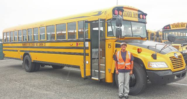Regina Brock with the new Blanchester school bus she'll be driving.