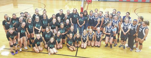 The Blanchester and East Clinton volleyball players and coaches with Shelly Johnson during the Volley For the Cure event at East Clinton Tuesday.