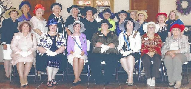 The Indian Trails Colonial Dames 17C Chapter at Tea. From left in the front row are Kay McIntire, Kim Stackhouse, Sharon Snowden, Leslie Holmes, Yvonne Hitshue, Nancy Bernard and Eva Botts; from left in the back row are Martha Saylor, Alice Stewart, Frances Sharp, Joyce Peters, Linda Lee, Susan Henry, Mary McConnell, Pat McKenzie, Barbara Scarboro, Karen McKenzie, Mary Ann Vantress and Barbara Daulton.