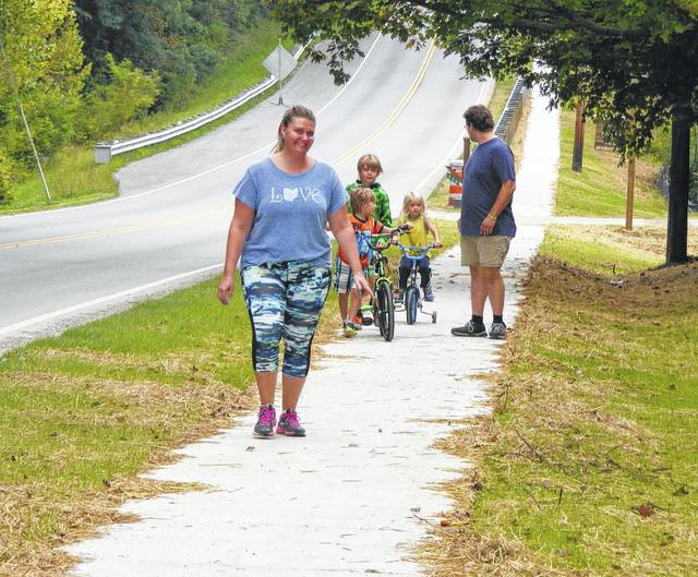 The new sidewalk along Truesdell Street in Wilmington is now being utilized by pedestrians, in this instance the Ben and Katrina Dean Family. On a recent morning the parents and their home-schooled children Ethan, Samuel and Landon were taking a walk or a ride on the new concrete pathway. The mother said she loves the sidewalk.