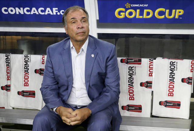 """FILE - In this July 22, 2017, file photo, United States head coach Bruce Arena sits on the bench prior to a CONCACAF Gold Cup semifinal soccer match against Costa Rica, in Arlington, Texas. Arena has resigned in the wake of the teams U.S. national team's crash out of contention for the 2018 World Cup. """"We didn't get the job done, and I accept responsibility,"""" Arena said in a statement on Friday, Oct. 13, 2017.(AP Photo/LM Otero, File)"""